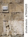 old street number 113 on stone...   Shutterstock . vector #679044205