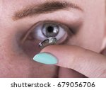 young woman putting contact... | Shutterstock . vector #679056706