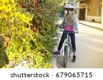 the girl on a bicycle stopped... | Shutterstock . vector #679065715