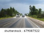 two cars going on the road... | Shutterstock . vector #679087522