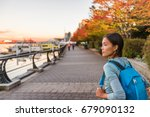Stock photo vancouver city urban lifestyle people at harbour british columbia woman tourist with student 679090132