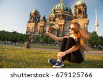 pretty gil sitting in front of... | Shutterstock . vector #679125766