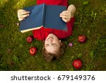 teen boy reading a book in the... | Shutterstock . vector #679149376