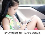 happy asian girl playing game... | Shutterstock . vector #679160536