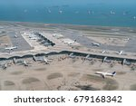 Aerial view of international airport with airplane parking. Hong Kong international airport.