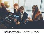 two businesswomen and man... | Shutterstock . vector #679182922