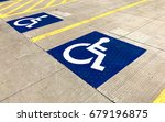 handicapped parking sign on a... | Shutterstock . vector #679196875