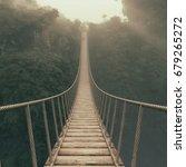 rope bridge suspended between... | Shutterstock . vector #679265272