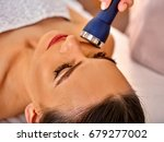 ultrasonic facial treatment on... | Shutterstock . vector #679277002