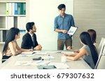 businessman presenting new... | Shutterstock . vector #679307632