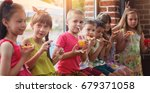 happy children eating pizza and ... | Shutterstock . vector #679371058