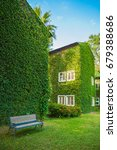 vintage house covered by green... | Shutterstock . vector #679388686