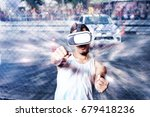 young man using virtual reality ... | Shutterstock . vector #679418236