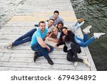 group of beautiful young people ... | Shutterstock . vector #679434892