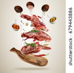 flying pieces of raw pork... | Shutterstock . vector #679443886