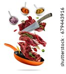flying raw steaks  with... | Shutterstock . vector #679443916