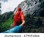 girl in a raincoat in the rain...   Shutterstock . vector #679451866