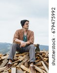 man in hat with ax sitting on... | Shutterstock . vector #679475992
