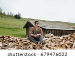 man in hat with ax sitting on... | Shutterstock . vector #679476022
