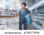 young asian tourist rushing to... | Shutterstock . vector #679477996