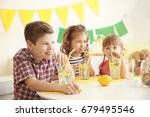 cute little kids drinking... | Shutterstock . vector #679495546