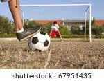 Penalty shootout in amateur football - stock photo