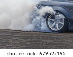 Small photo of Drifting car, Sport car wheel drifting and smoking on track, Abstract texture and background black tire tracks skid on asphalt road, Wheel tire tracks background, Car tire track skid mark.