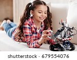 attentive girl looking... | Shutterstock . vector #679554076