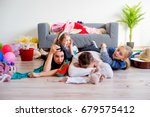 tired parents and romping kids | Shutterstock . vector #679575412