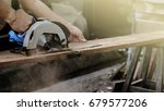Carpenter Using Circular Saw...