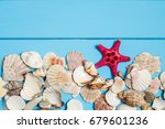 seashell on wooden background... | Shutterstock . vector #679601236