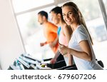 group of friends exercising on... | Shutterstock . vector #679607206