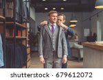 mature tailor and customer in... | Shutterstock . vector #679612072