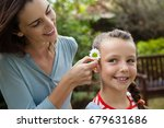 smiling mother positioning... | Shutterstock . vector #679631686