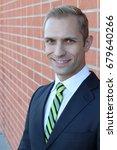 man gracefully wearing a suit | Shutterstock . vector #679640266