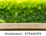 empty wood table top on blur... | Shutterstock . vector #679646296