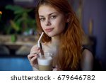 woman with latte in cafe        ... | Shutterstock . vector #679646782