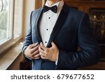 groom in blue suit | Shutterstock . vector #679677652