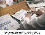 business man seeing wristwatch... | Shutterstock . vector #679691932