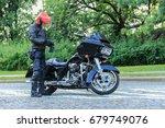 Motorcyclist In Red Helmet Is...