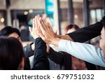 teamwork join hand group... | Shutterstock . vector #679751032