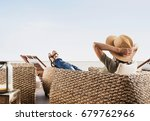 young woman resting on hotel... | Shutterstock . vector #679762966
