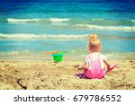 baby girl playing in the sand... | Shutterstock . vector #679786552