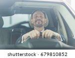 handsome mature man looking... | Shutterstock . vector #679810852