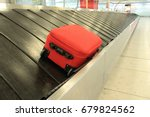 baggage claim suitcase on... | Shutterstock . vector #679824562