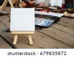 blank miniature canvas on a... | Shutterstock . vector #679835872