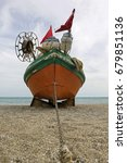 old fishing boat on empty beach | Shutterstock . vector #679851136