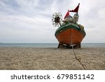 old fishing boat on empty sandy ... | Shutterstock . vector #679851142