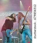 Small photo of KIEV, UKRAINE - JULY 02, 2017: Ukrainian stoner rock band Stoned Jesus and its guitarist Igor Sydorenko and bass guitarist Sergii Sliusar performs live at the Atlas Weekend Festival in Expocenter.