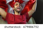 canadian guy waving canada flag | Shutterstock . vector #679886752